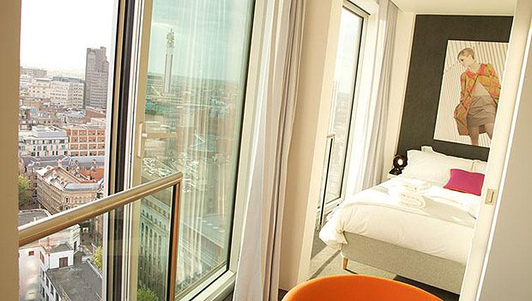 Bed and views at Compact bedroom in Staying Cool at The Rotunda
