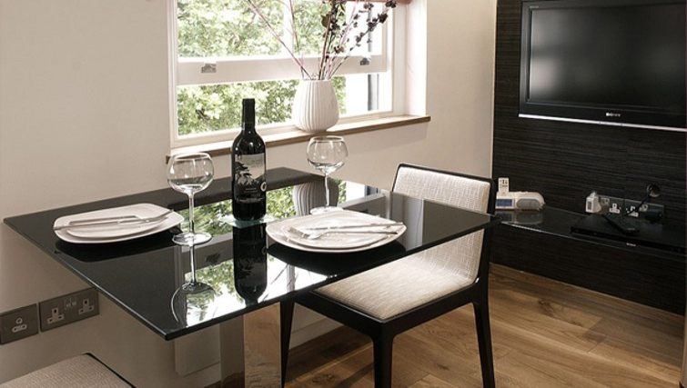 Compact dining area in Space Apartments