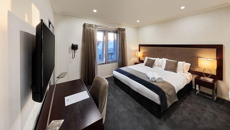 Bed at Attika Apartments