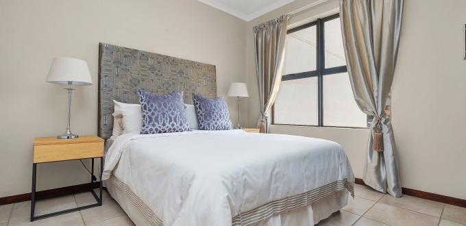 Bright bedroom in ExecutiveTwelve Apartments