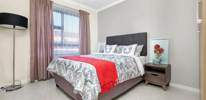Comfortable bedroom in ExecutiveTwelve Apartments