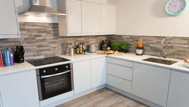Equipped kitchen at Cotels at 7Zero1 Apartments