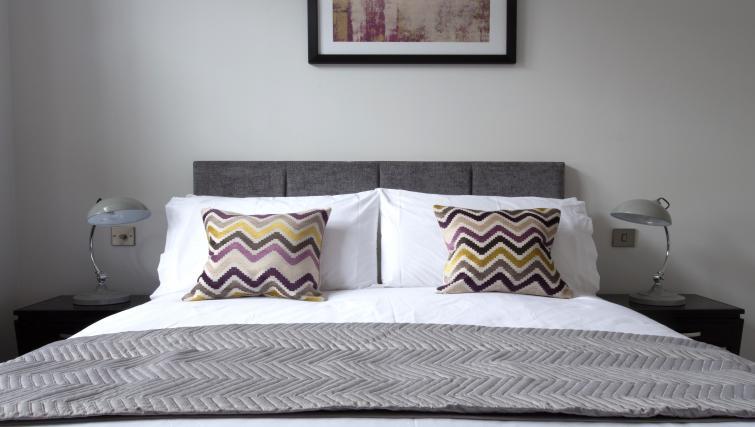 Bed at Cotels at 7Zero1 Apartments
