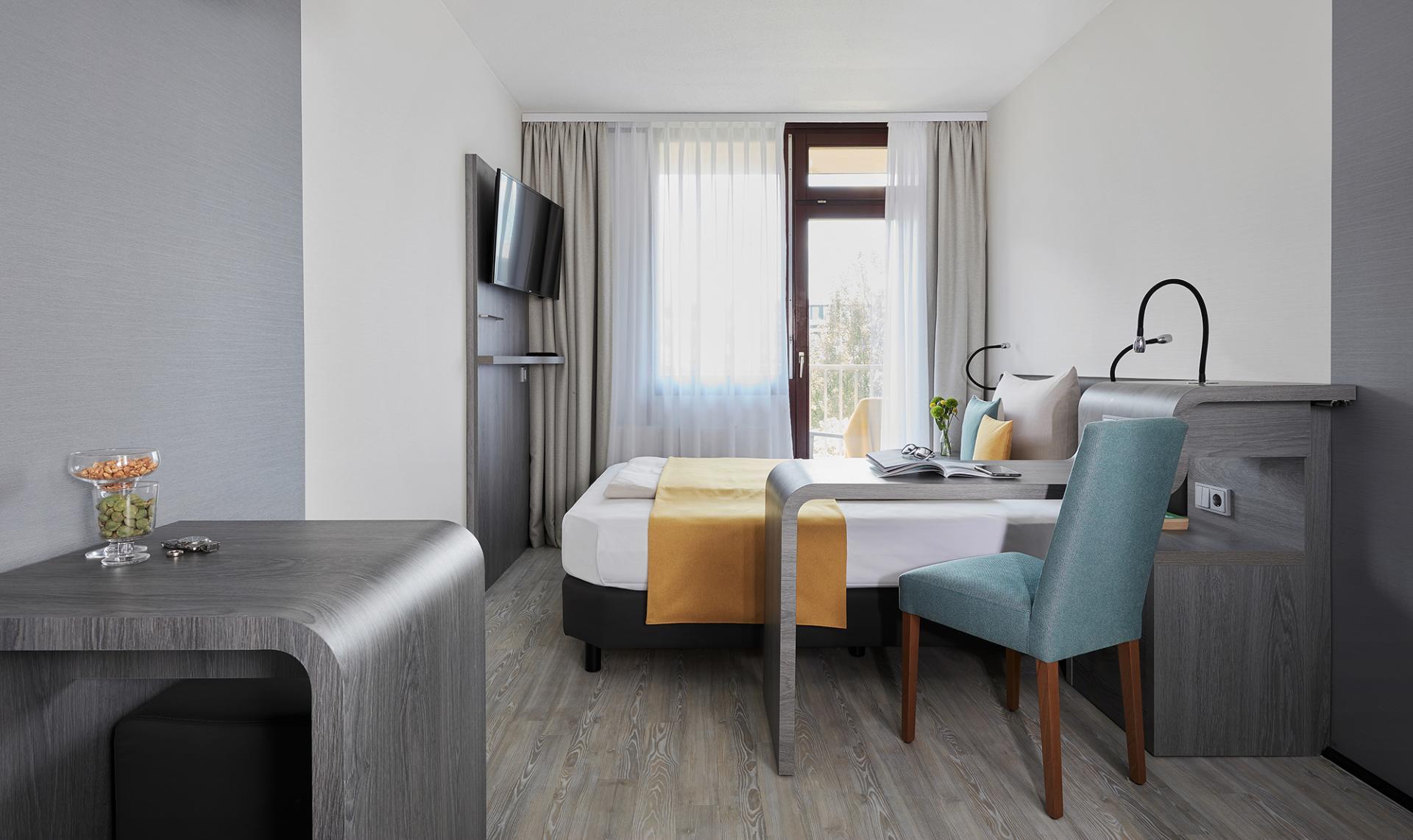 Bed at Living Hotel Deutschen Museum Apartments, Haidhausen, Munich