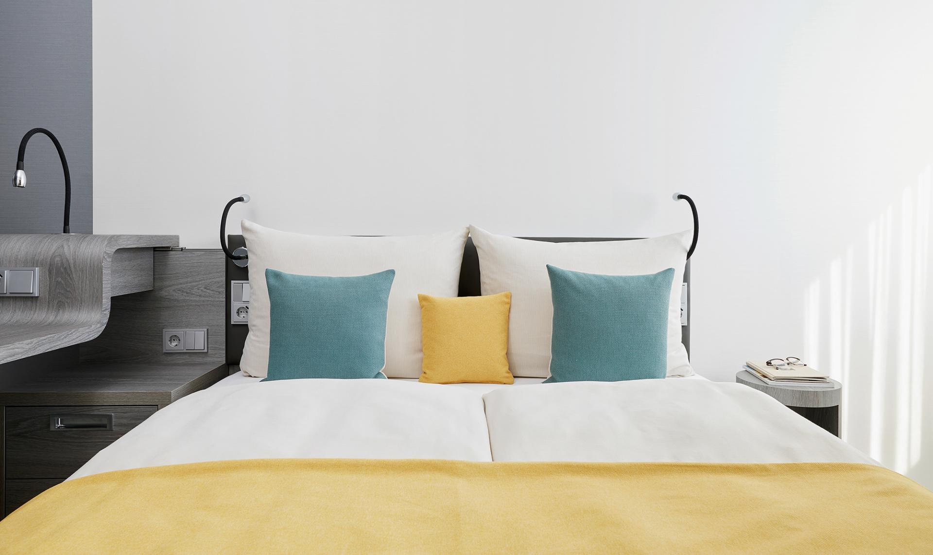 Comfy bed at Living Hotel Deutschen Museum Apartments, Haidhausen, Munich