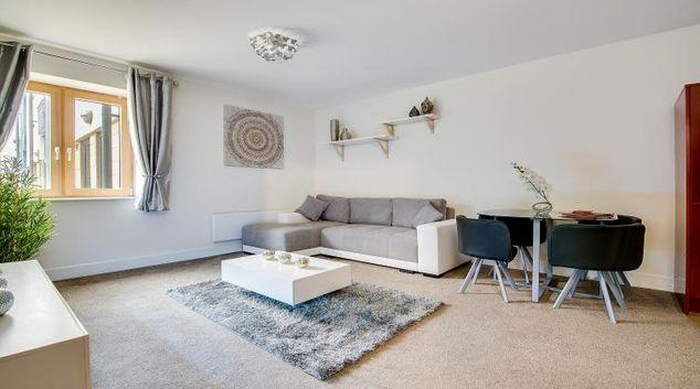 Sofa at The Mailbox Apartment