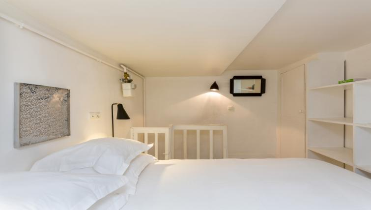 White bed at Opera Septembre Apartments, 2nd Arr, Paris