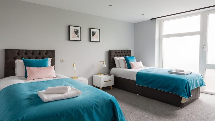 Twin beds at Alexandra Road Apartments