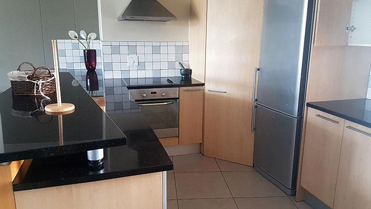 Equipped kitchen at Weom Apartments