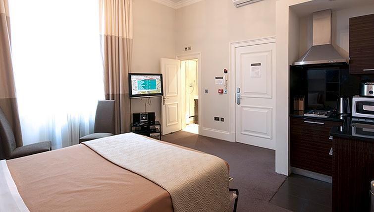 Multifunctional bedroom at 20 Hertford Street Apartments