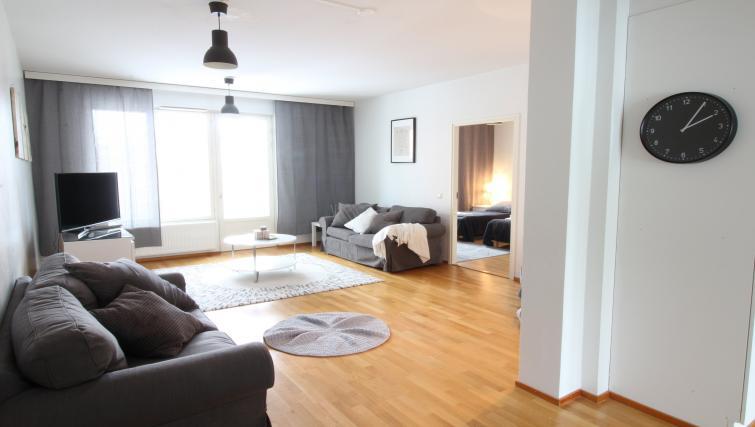 Sleek wooden flooring at the Lähettilääntie Apartment