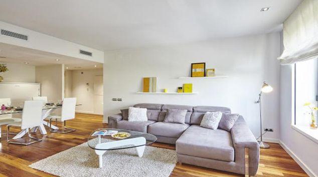 Living area at Paseo de Gracia Apartments