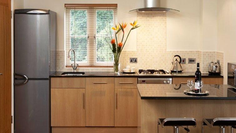 Modern kitchen in Netherstowe House Mews