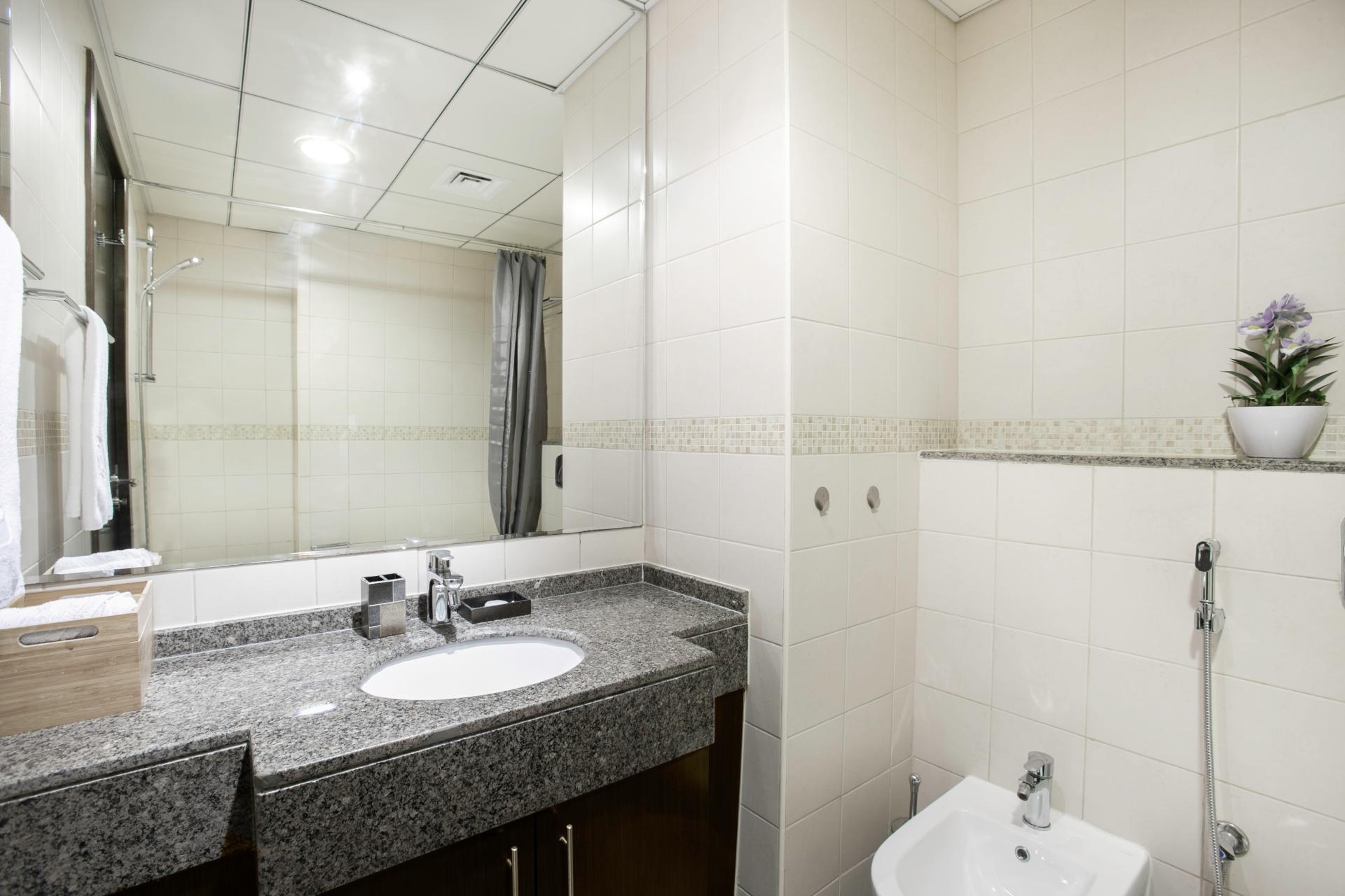 Bathroom vanity at Royal Oceanic Apartment