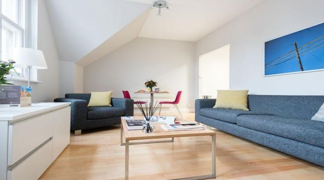 Living room at the Premier Suites Plus Bath Street Apartments