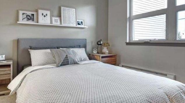 Bed at the AMLI Mark24 Apartments