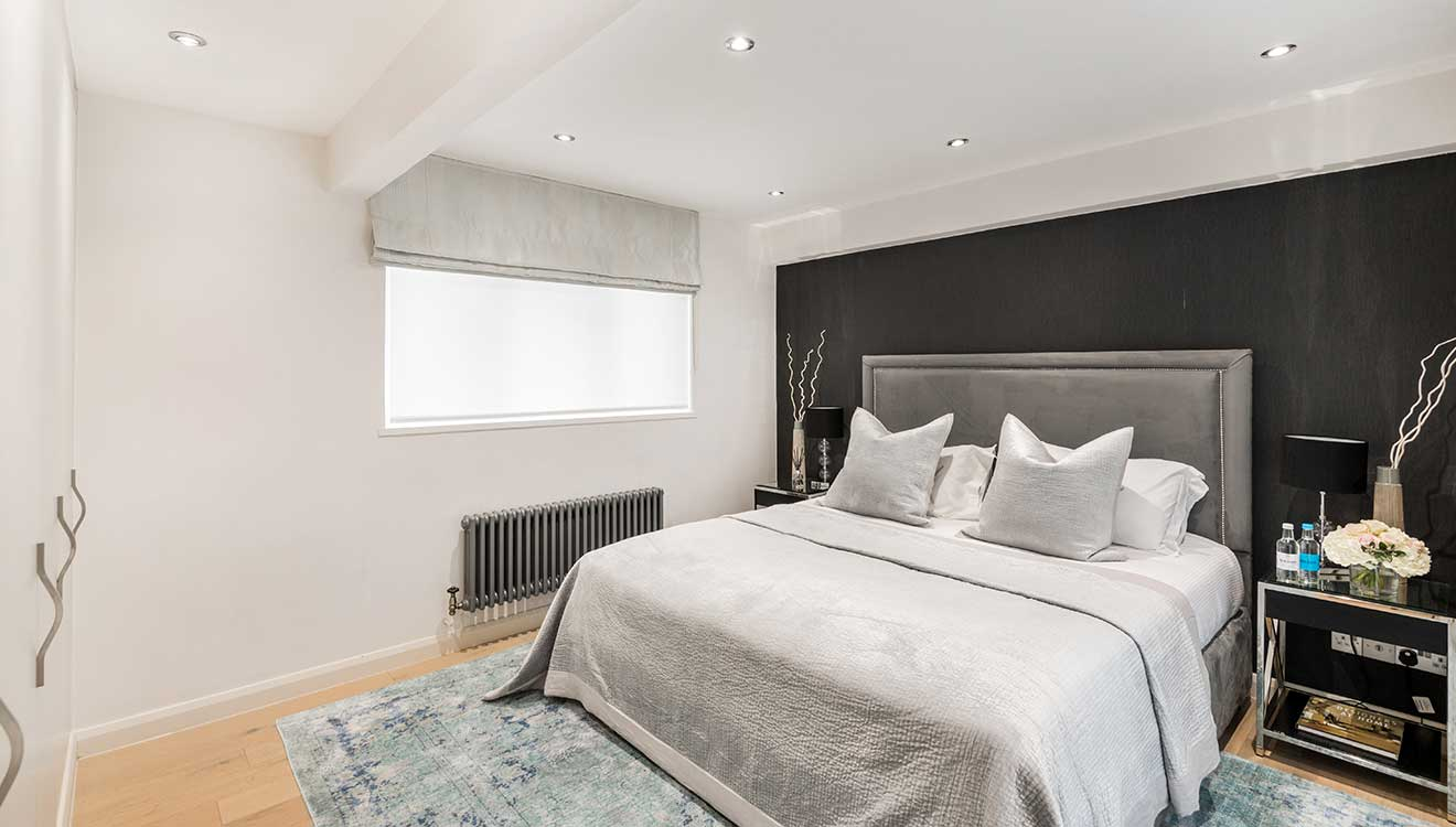 Grey bedroom at Hyde Park Gate Apartments