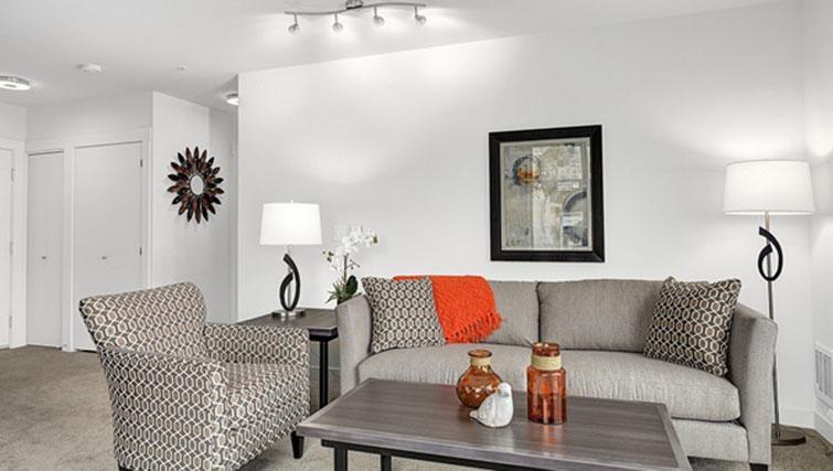 Living room at AMLI SLU Apartments