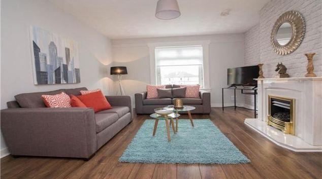 Living room at Elderpark View Apartment