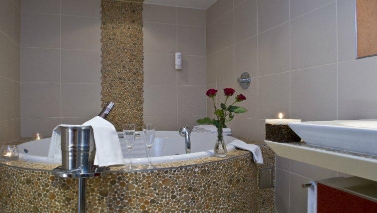 Tranquil jacuzzi bathtub in Mamaison Residence Diana