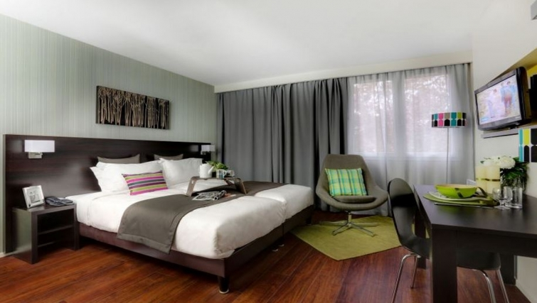 Stylish bedroom in Citadines Part-Dieu Apartments