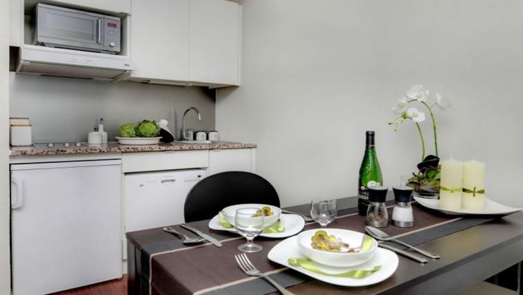 Compact kitchen in Citadines Part-Dieu Apartments