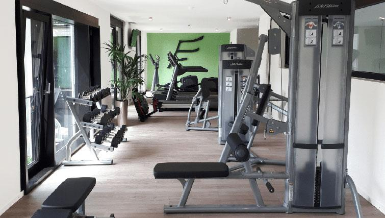 Gym at THE FLAG München Apartments