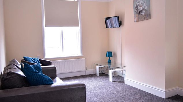 Living room at Orrell House Apartments
