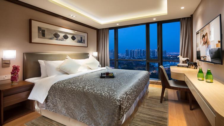 Bedroom at Somerset Baitang Suzhou Apartments