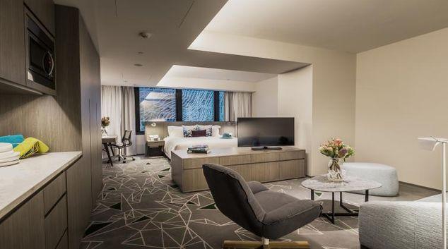 Living room at Brisbane Capri by Fraser