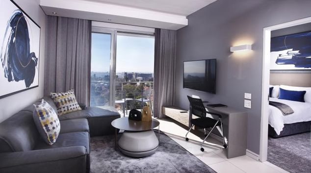 Living room at On The Park Apartments