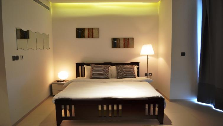 King size bed at West Avenue Tower Apartments