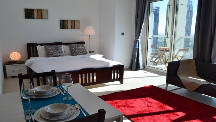 Double bed at West Avenue Tower Apartments