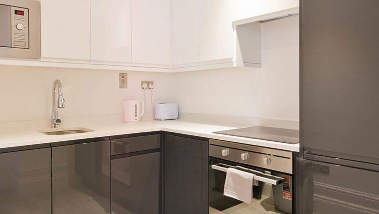 Equipped kitchen at Suesey Place Apartments