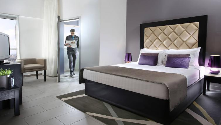 Double bed at Citadines Metro Central Dubai Apartments