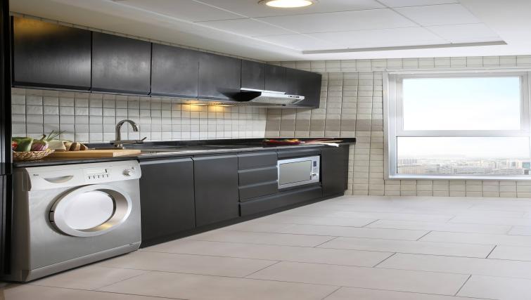 Kitchen at Citadines Metro Central Dubai Apartments