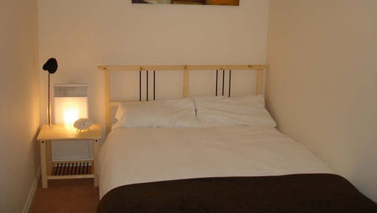 Warm bedroom in Darlington Apartments