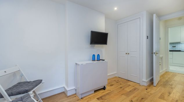 TV at Fitzroy Square Apartment, Warren Street, London