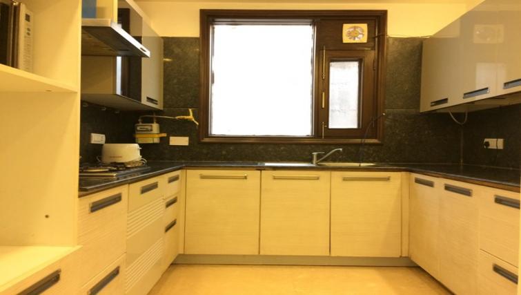 Kitchen at  Saket Serviced Apartments