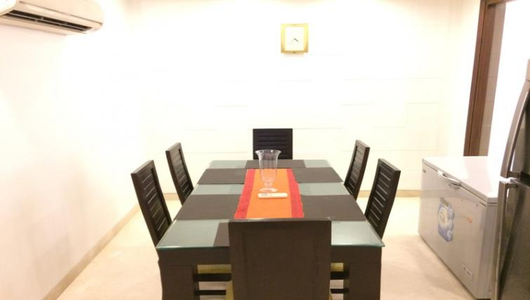 Dining table at  Saket Serviced Apartments