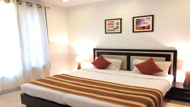 King size bed at  Saket Serviced Apartments