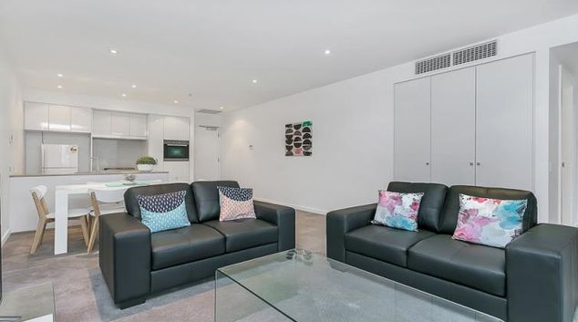 Living room at Astra Adelaide Hindmarsh Square Apartments