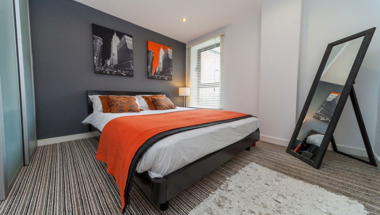 Modern bedroom at West One Apartments
