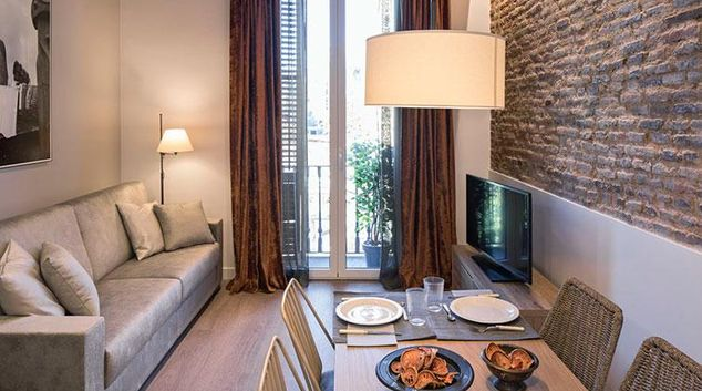 Living room at Pau Claris Bijou Apartment
