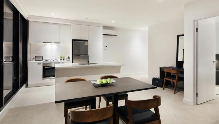 Kitchen at Experience Bella Hotel Apartments