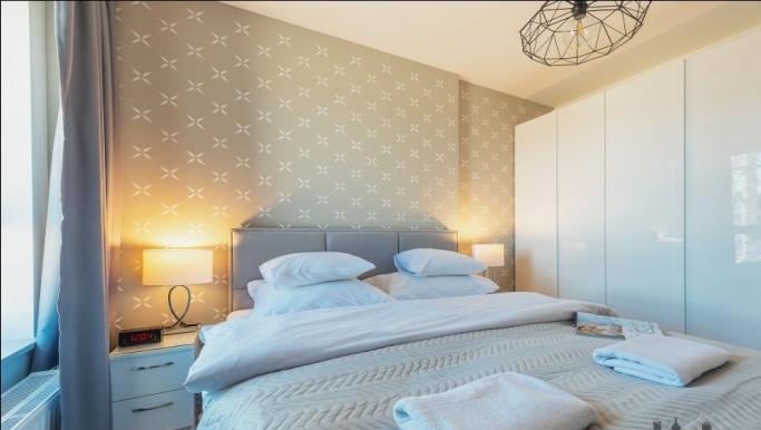 Modern bedroom at Konstruktorska Apartment