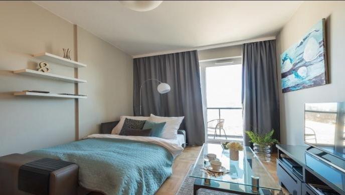 Bright bedroom at Konstruktorska Apartment