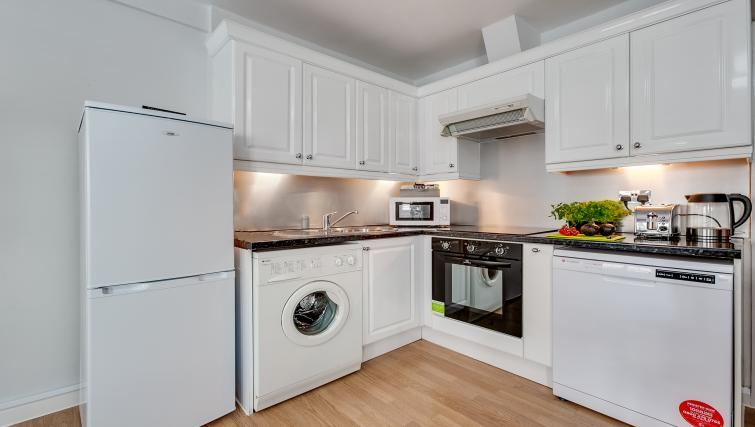 White kitchen at Nell Gwynn Chelsea Accommodation