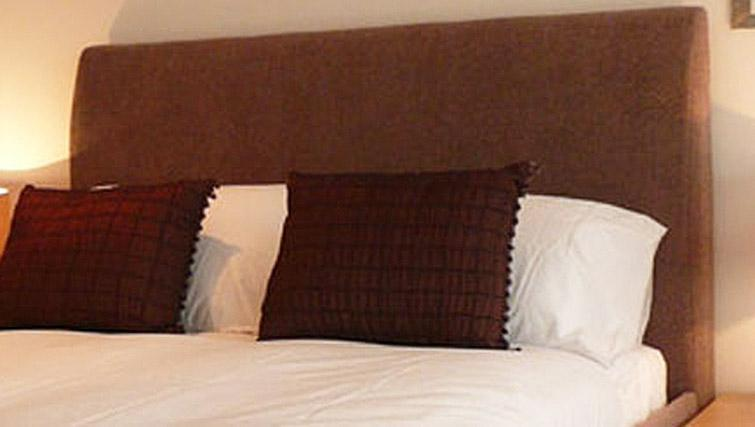 Bed at Quay Serviced Apartments