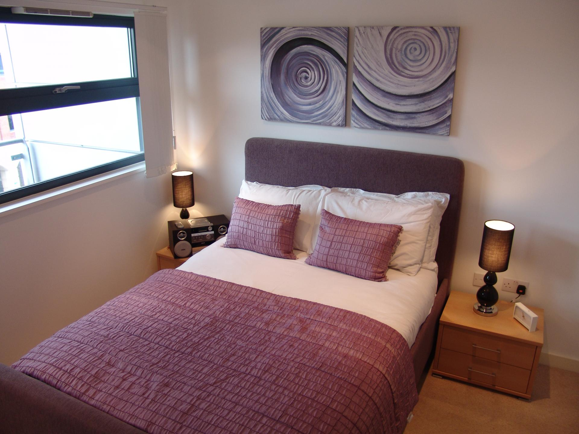 Double bed at Quay Serviced Apartments